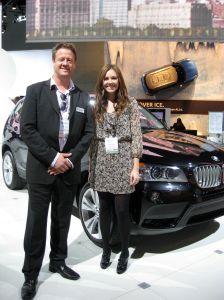 Writer Collins Reiter with Erik Goplan at the LA Auto Show with his winning X3 design.